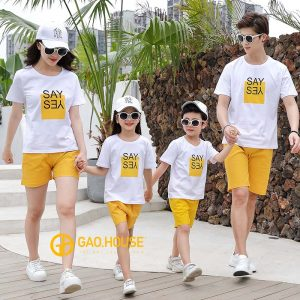 A group of people wearing matching t-shirts and shorts Description automatically generated with low confidence