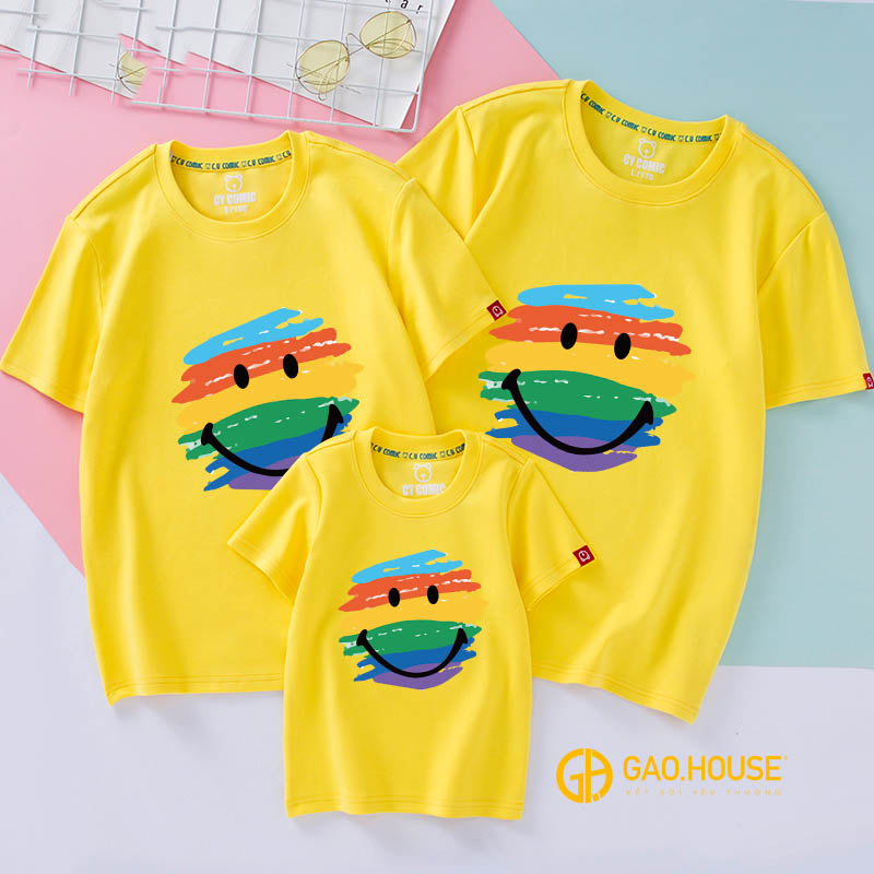 A yellow t-shirt with cartoon faces on itDescription automatically generated with low confidence